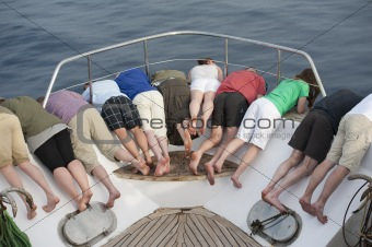 Group of people looking over bow of a boat