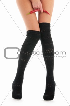 Beautiful female legs with red pepper