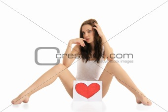 woman sitting on the floor with painted hearts
