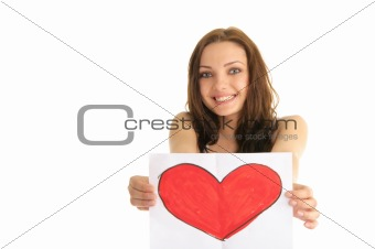 Young woman holding a painted heart