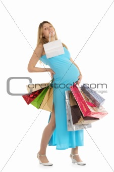 tired pregnant woman with shopping