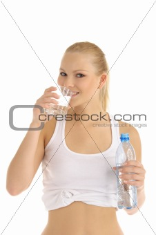 happy woman drinks water from a glass