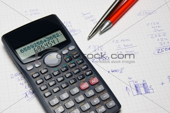 Mathematical calculator and hand counts in the background