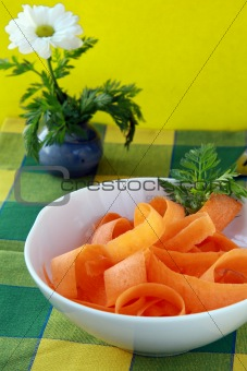 Carrot salad in white bowl  wiath basil