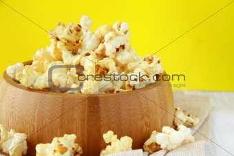 classic popcorn  in a wooden cup