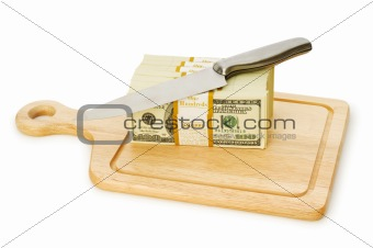 Money concept - cutting dollars with the knife