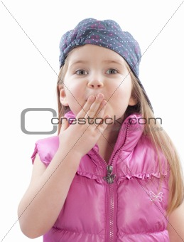 little girl covers mouth