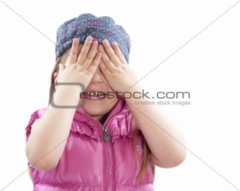 little girl covers face with hands