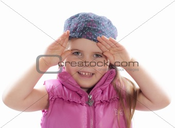 little girl opens eyes with hands
