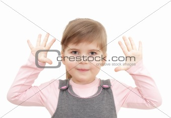 little girl rises hands up and shows ten fingers