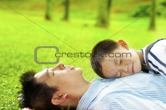 Boy asleep on dad's chest