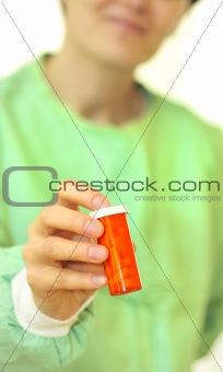 doctor holding bottle of prescription pills