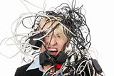 Mature businesswoman's screaming in cables.