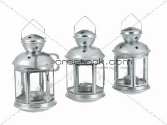 Tin grey metal lantern trio row