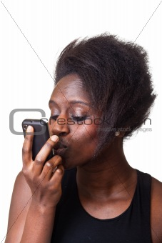 Beautiful Black Woman kissing mobile Phone