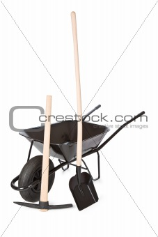 wheelbarrow with shovel and pick