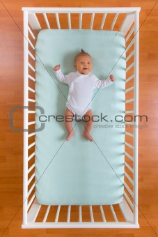 top view of baby in cot