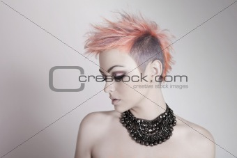 Attractive Young Woman With a Punk Hairstyle