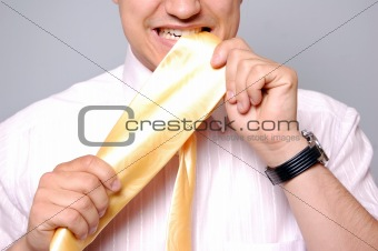 Young men could't select tie. Studio shot.