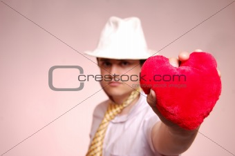 Beautiful man in cap with heart.