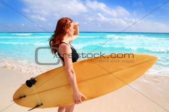 side view surfer woman tropical sea looking waves