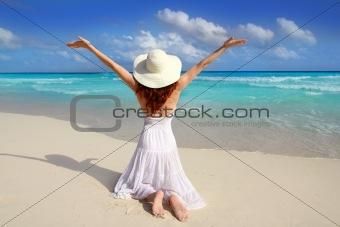 Caribbean beach woman rear on knees open arms