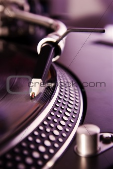 Vinyl record player spinning the disc