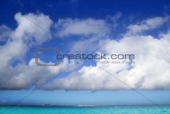 Cumulus clouds over caribbean turquoise sea