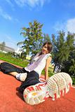 sport girl sitting in sport field
