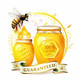 Glass jar with honey and bee