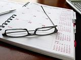 Monthly planner with glasses