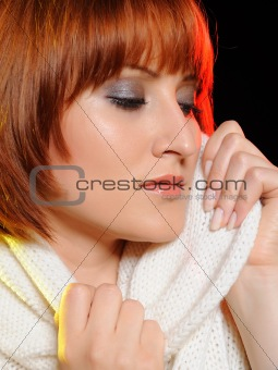 Beautiful woman face with natural make-up in warm winter clothes