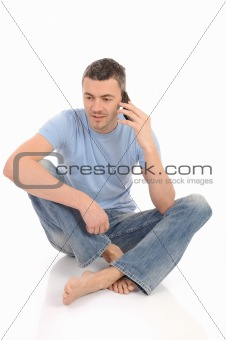casual young man speaking on the mobile phone. isolated