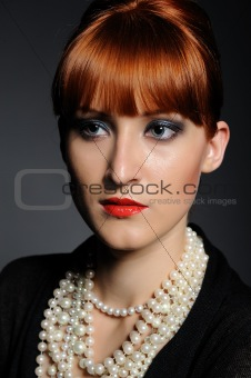Beautiful fashion retro woman with pearl necklace