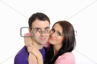 pretty young couple in love embracing. isolated on white
