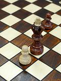 wooden chess figures on brown game board