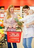Two Friends Buying Groceries with Baby