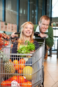 Portrait of playful couple in shopping store