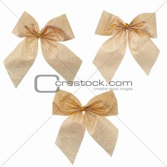 Three gift gold ribbon and bow