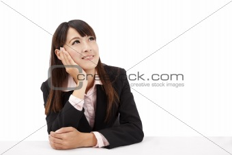 Asian Business woman looks upward and thinks