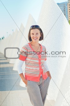 A young woman walking of modern building