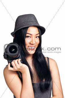 Young asian girl posing with a camera