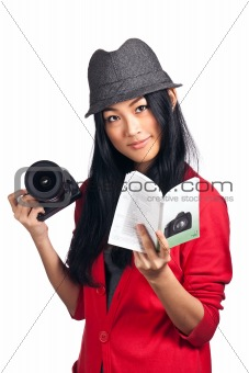 Girl reading a camera user manual
