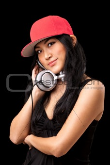 Female DJ listening to music