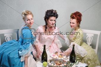 Three ladies in historical dresses