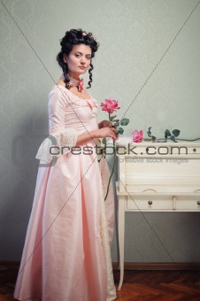 A young lady in a pink historical dress