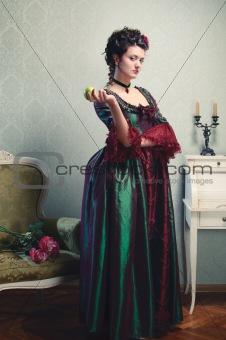 Beautiful brunette in a historical dress