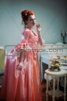 A gorgeous red-haired lady in a lavish ancient dress