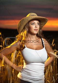 Attractive young lady in a straw hat