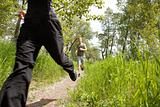 Friends jogging in forest
